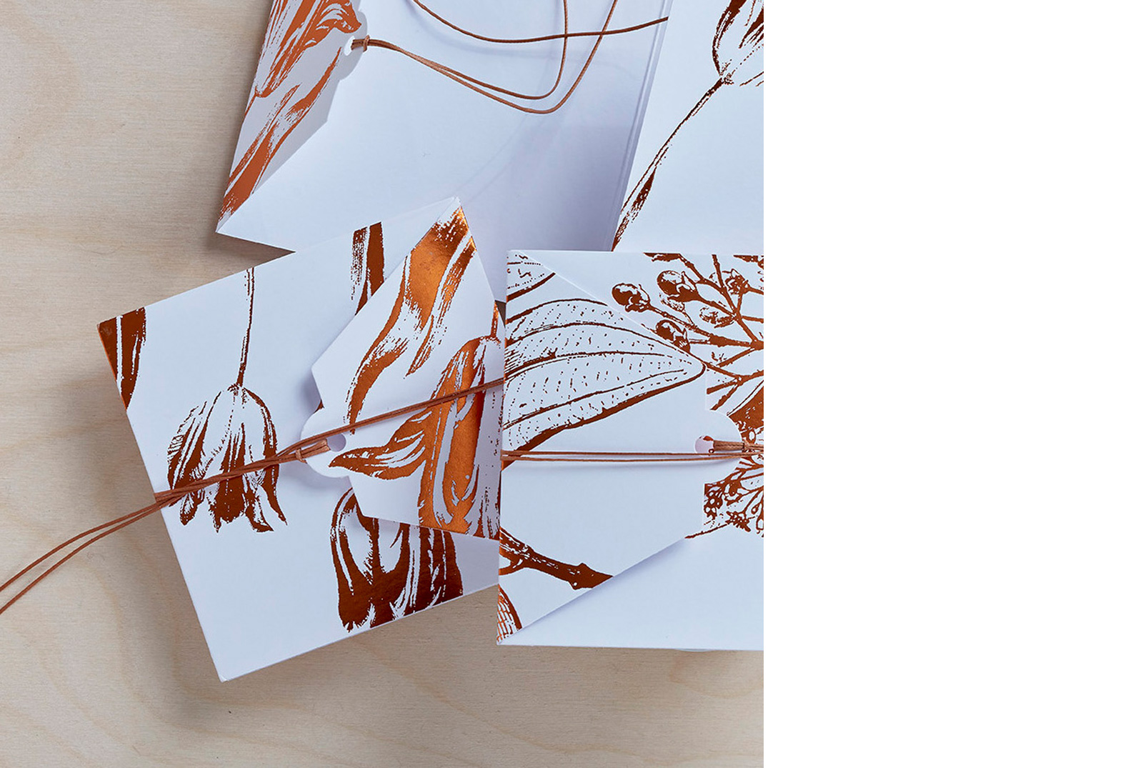 Sanne Lindberg Cards in COPPER. Shiny, embossed COPPER on crispy white. The cards measure, when folded; 12 cm x 12 cm. Folds out to triple size.